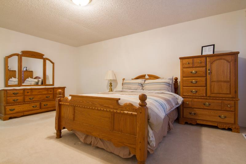 Spacious Master Bedroom with Oak Furniture