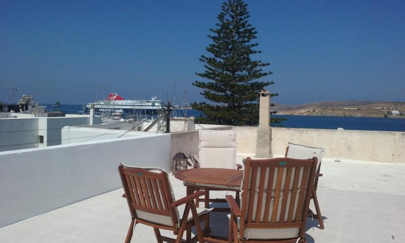 Sunny terrace with port view! (Big sun umbrella provided too)