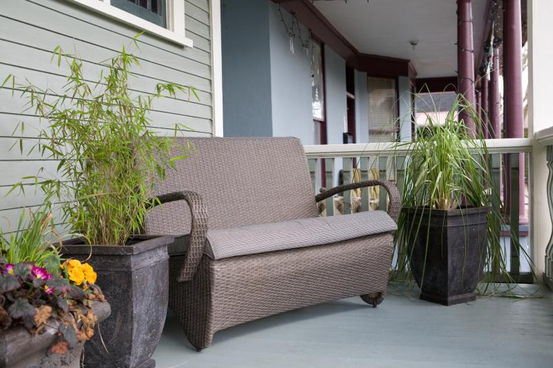 Guest seating area on main floor veranda of the Bee & Thistle Guest House.