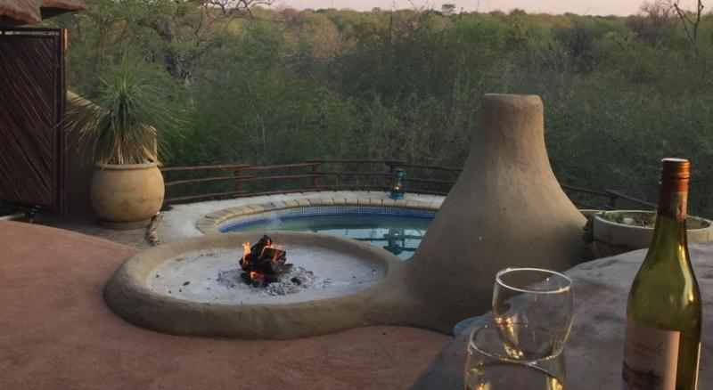 View out from the patio bar over fire pit and pizza oven