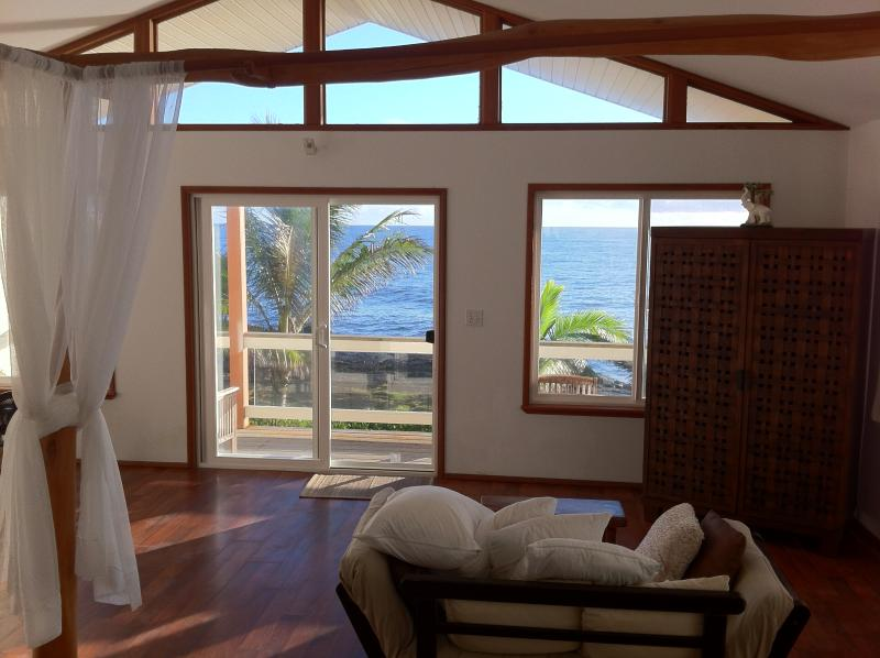 Watch whales and dolphins from your king sized platform bed at Hale Mar!