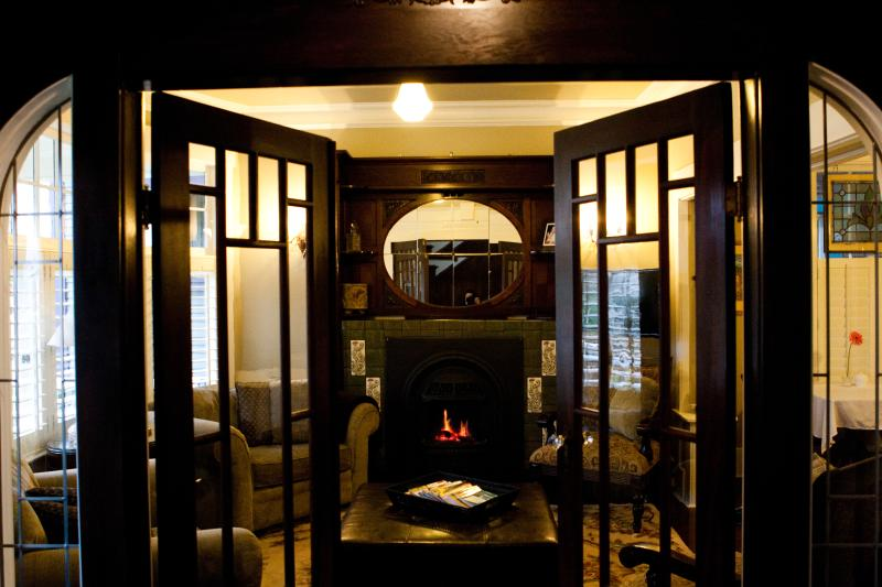 Bee & Thistle Guest House lounge with antique fireplace surround.