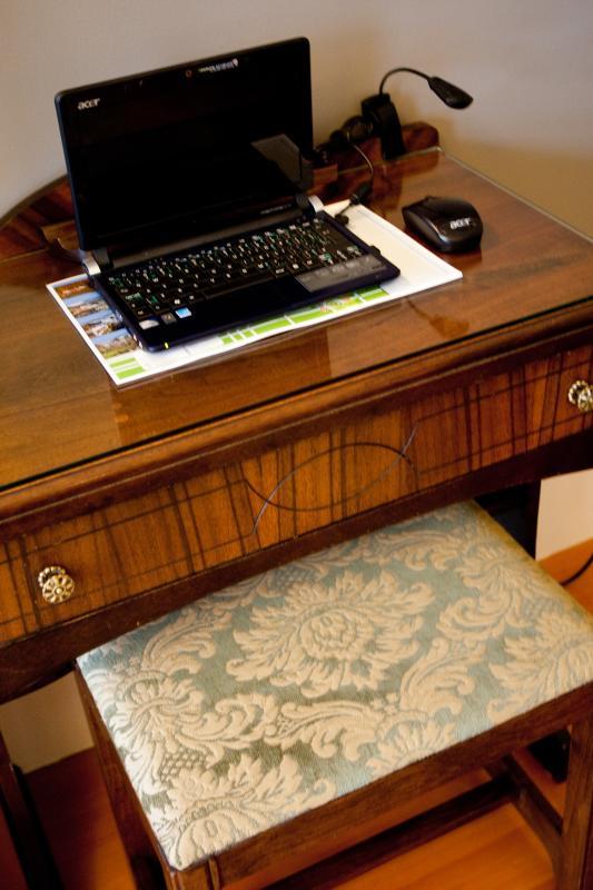 Ivy Room - antique desk with netbook computer.