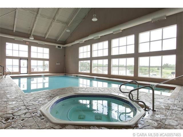 Pool/hot tub in amenities building - with outdoor sundeck overlooking lake.