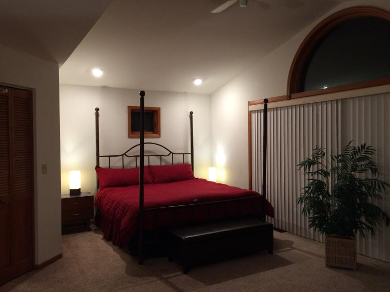 400 sqft master bedroom with private balcony, vaulted ceiling, walk-in closet & king bed