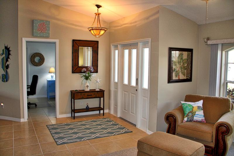 The home is warm and inviting as you can see here in the entry way.