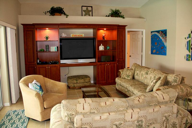 Family room has a large HDTV, Sonos system, Apple TV, Blu-Ray, & pool access.