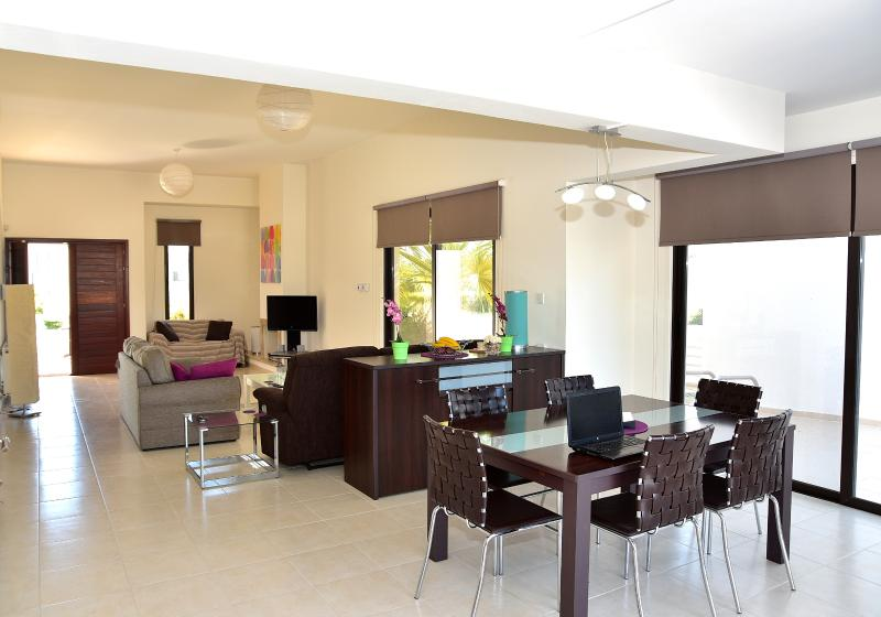 Open plan living dining area light and airy.