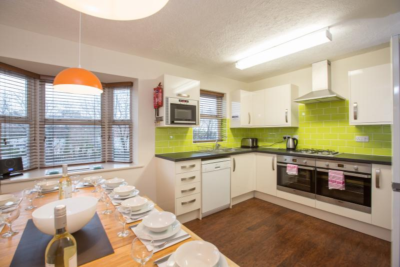 Kitchen Diner, seats 15,  Two full size ovens with grills, fridge freezer,  microwave, dishwasher
