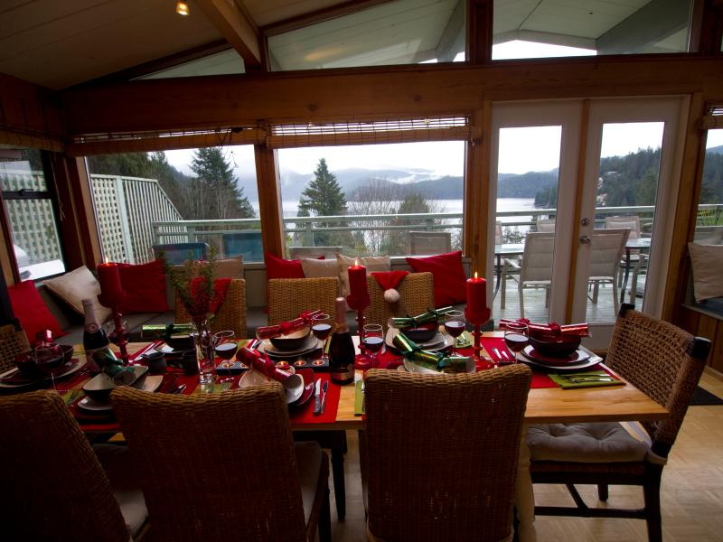 Dining Room Table with Deck and View beyond.