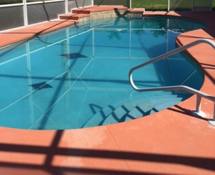 Over sized pool featuring waterfall.  Pool was just resurfaced and re-tiled.