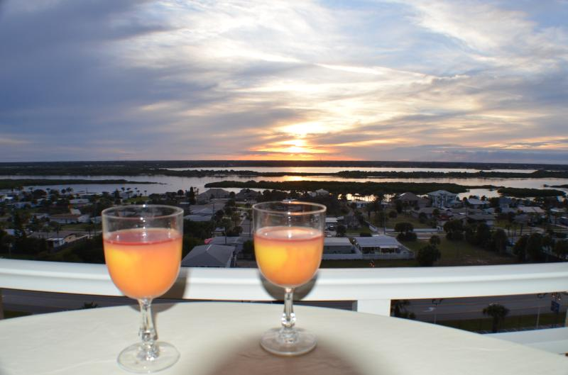 Enjoy beautiful sunsets on the Halifax River/ICW on the walkway balcony with patio table and stools