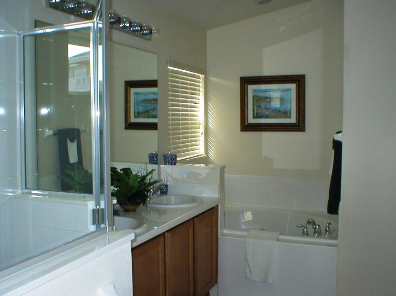 Master Bedrooms en-suite with shower cubicle and bath tub
