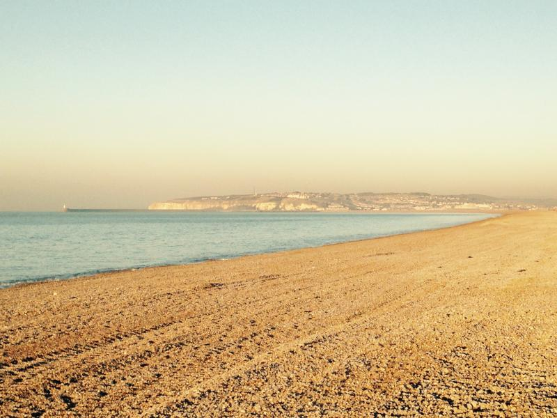 Seaford 3 mile beach with view towards Newhaven Lighthouse