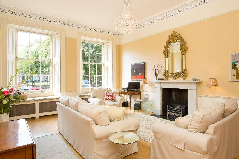 Twin Windowed Sitting Room with Living Flame Fire