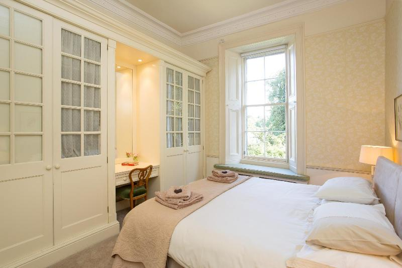 Master Bedroom with Window Seat views to Garden