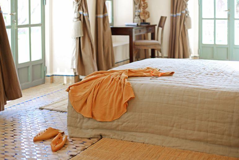 Beautiful en suite bedrooms leading to garden and pool