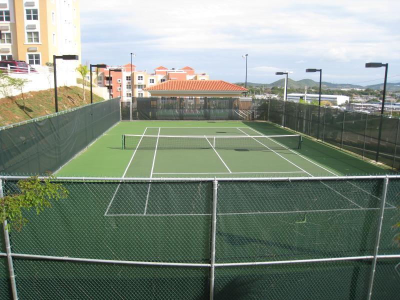 Lighted Tennis court.. give your best shot..!! Raquects & ball included