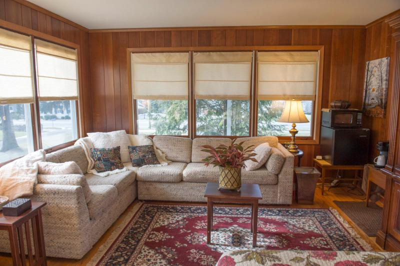 Sitting area in paneled bedroom