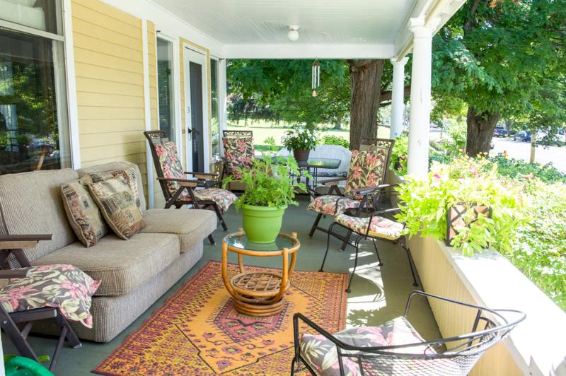 Large, inviting porch overlooks Main Street for gracious entertaining