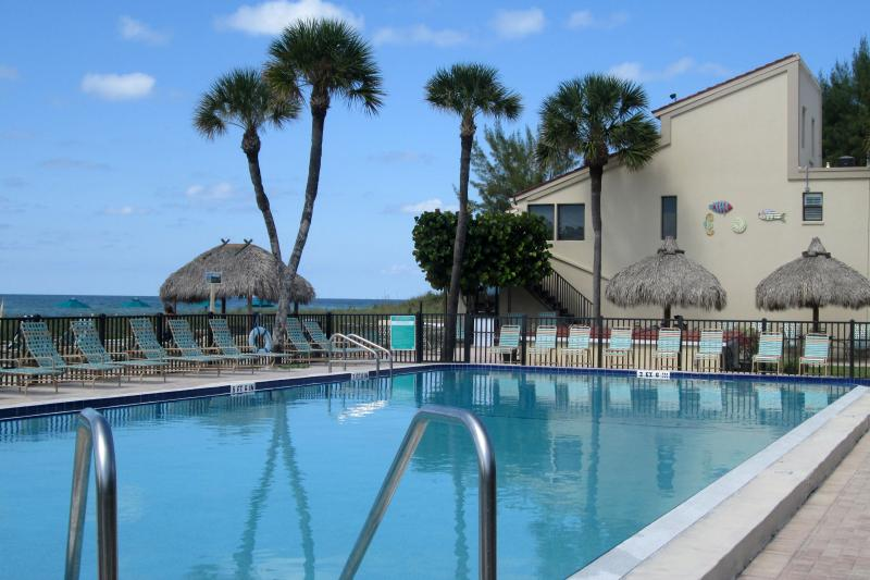 Pool is 25 x 60 ft., directly adjacent to the beach and Gulf, and is heated to 86F.