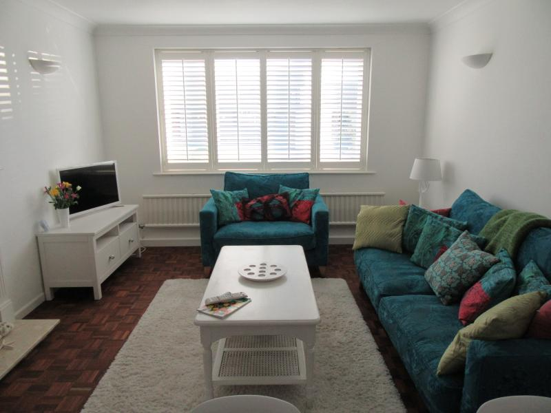 Bright living room with plantation shutters