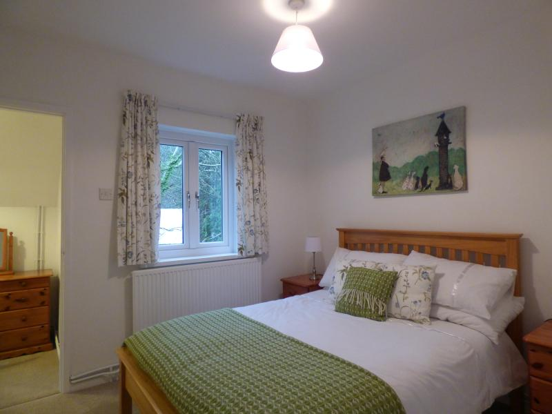 Bedroom 2 with double bed and dressing room.