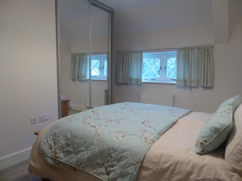 Second Double bedroom showing mirrored built in wardrobes.