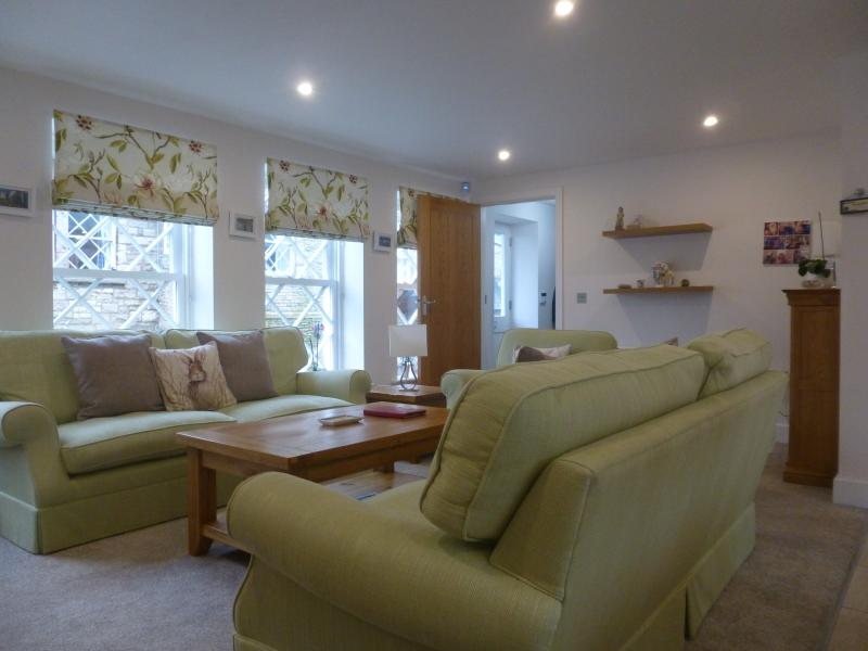 Open plan sitting area - looking towards the hall.