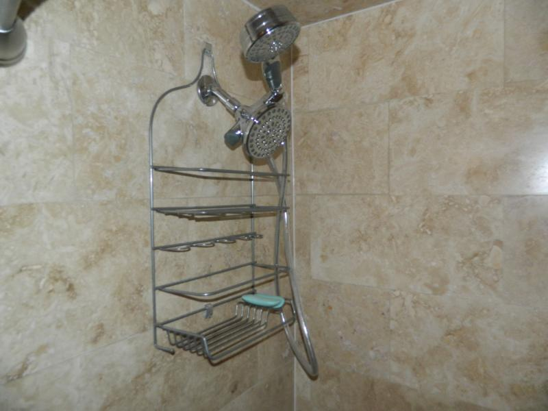Dual shower heads with a hand held wand.