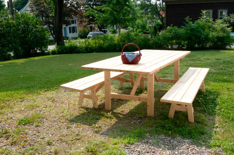 Large picnic table in spacious yard. Great for family play and relaxing