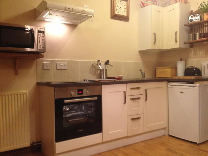 Kitchen area with Bosch oven and hob,microwave,fridge..with washer/ dryer & freezer in utility room.