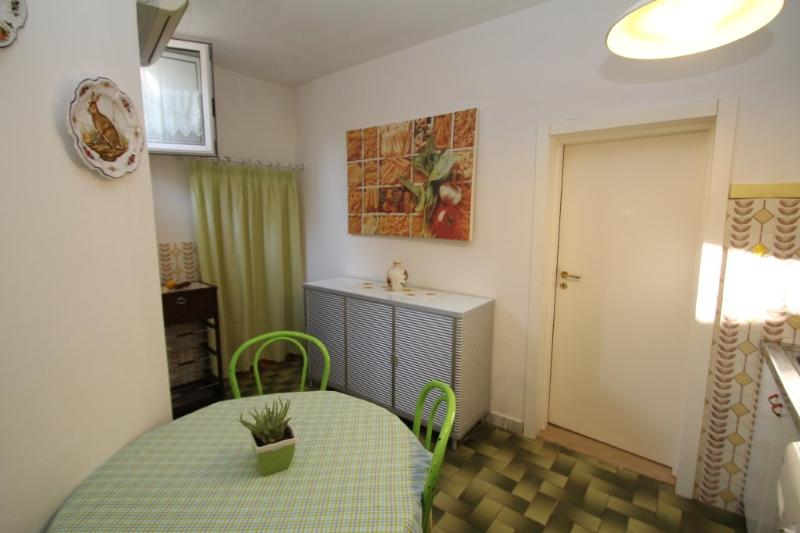 There is a small dining area in the kitchen which leads to a store room for all your groceries etc