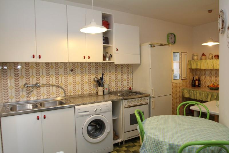 The kitchen is well equipped and has a large fridge freezer