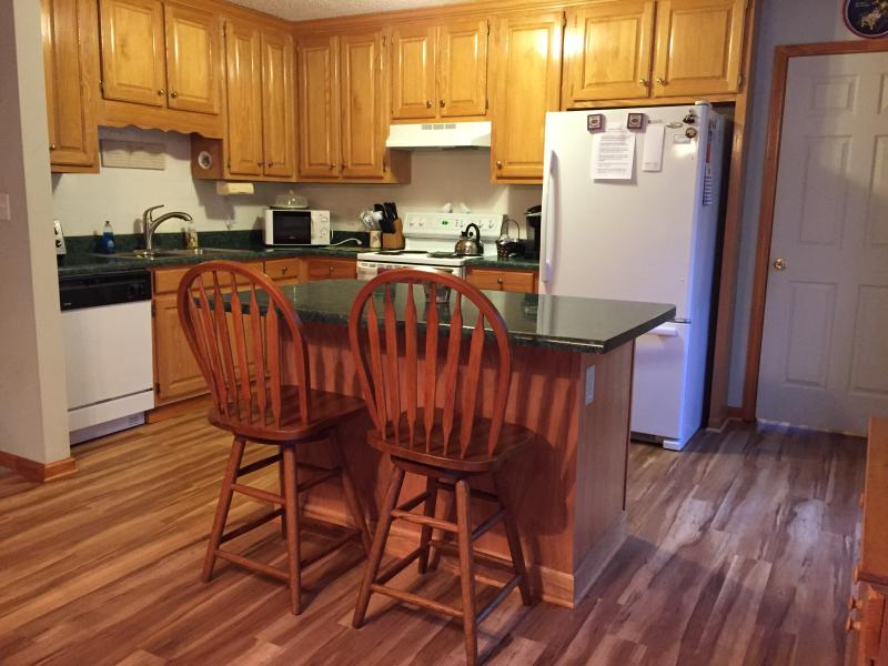 Kitchen with island seating and new floors installed in 2015.