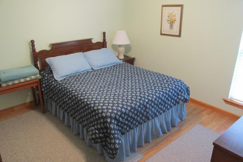 Guest room #2 with queen bed.