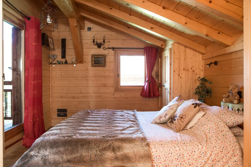gorgeous bedrooms, this one with balcony and ensuite bath under a velux