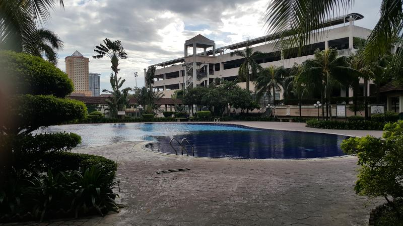 Clean and beautiful swimming pool. 24 hours KK supermart, food stalls just next to condo entrance.