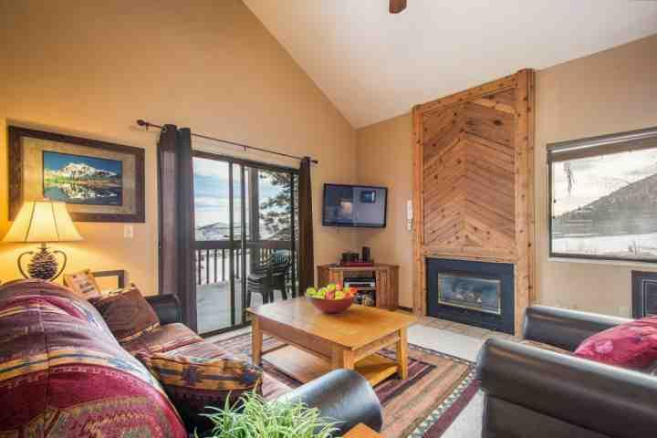 "The living room features a large living area with plush leather furniture, gas fireplace, a 42"" HDTV and a sliding glass door to access your balcony."