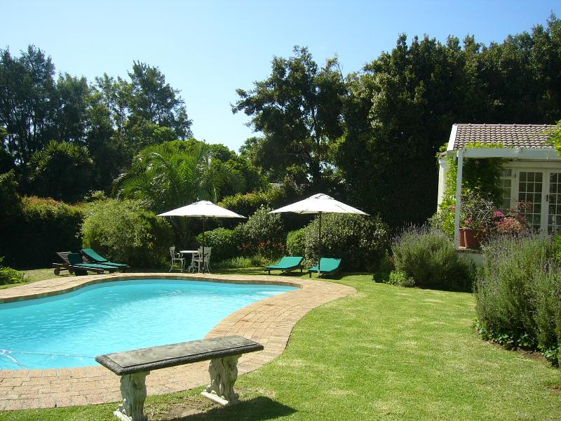 Cool off in the sparkling pool or relax under shady umbrellas on the loungers