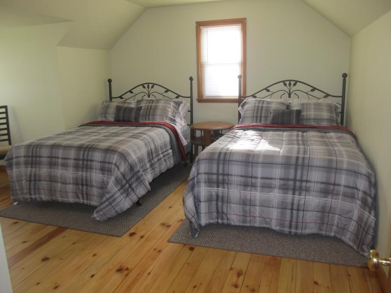 2nd upstairs bedroom with 2 full size beds.
