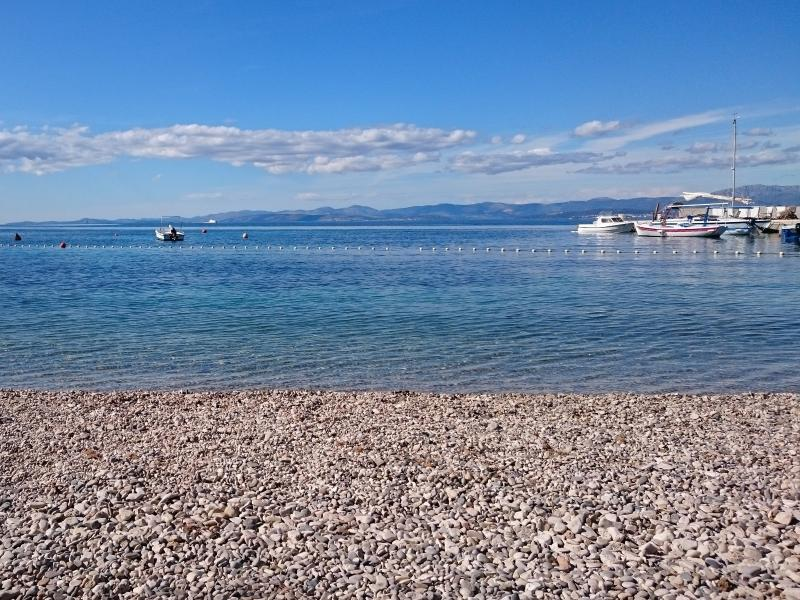 Beach and a small pier for local boats and speedboat transfers to the villa