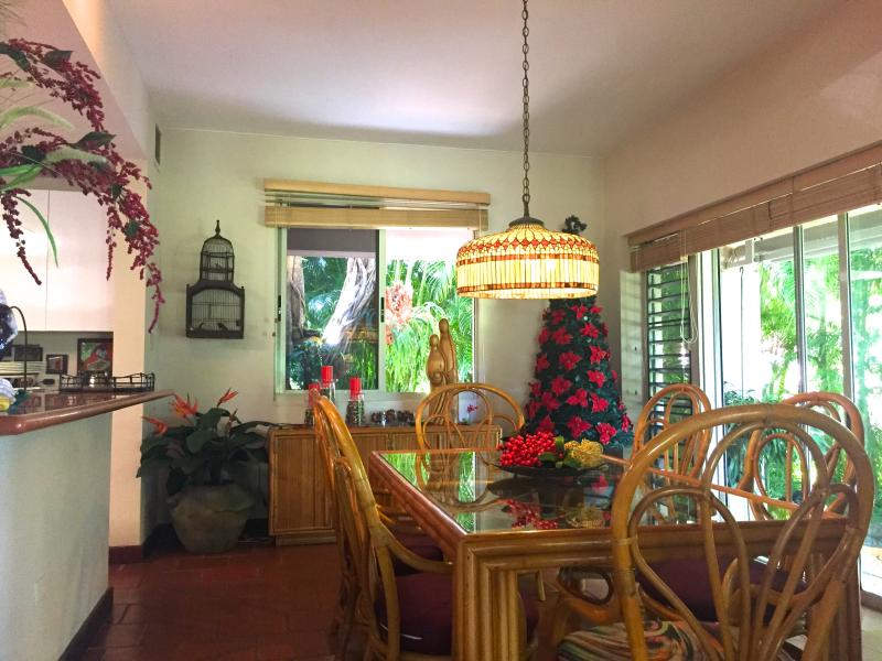Large dining area adjacent to kitchen for convenience