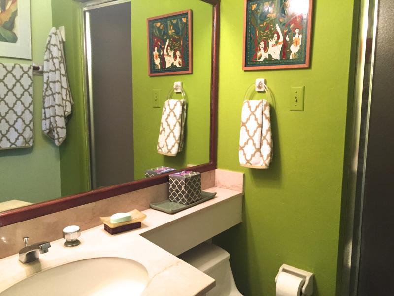one of three en-suite bathrooms