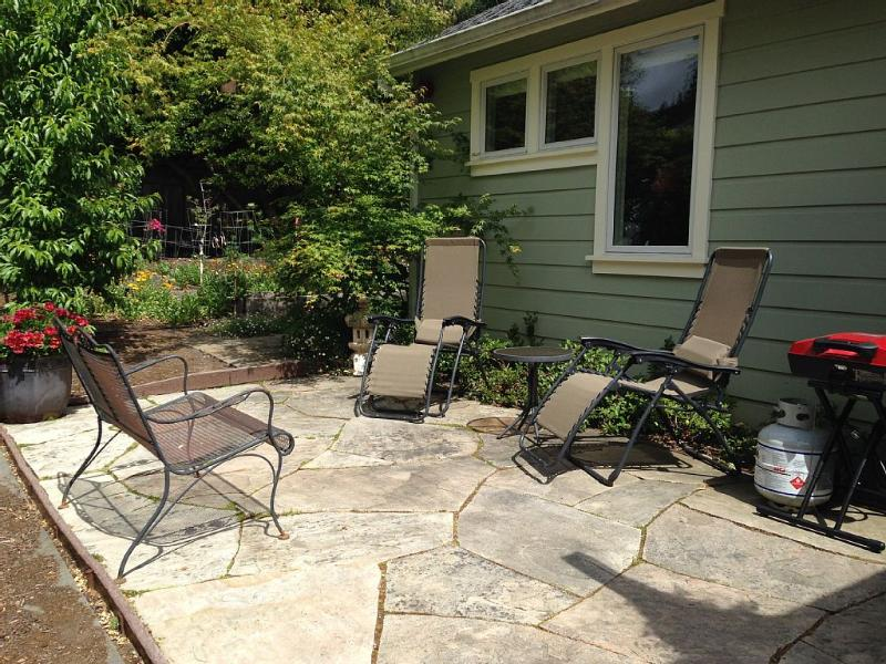 Private back patio with bbq.  There is also a bistro table with chairs and umbrella.