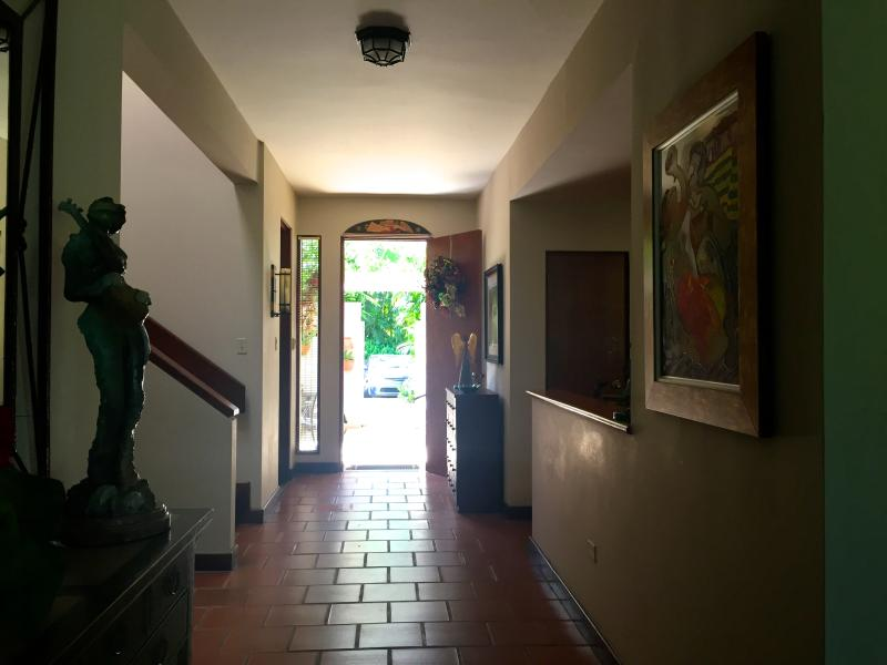 View to entry from hall wall- Mediterranean style tiles and tasteful art throughout villa.