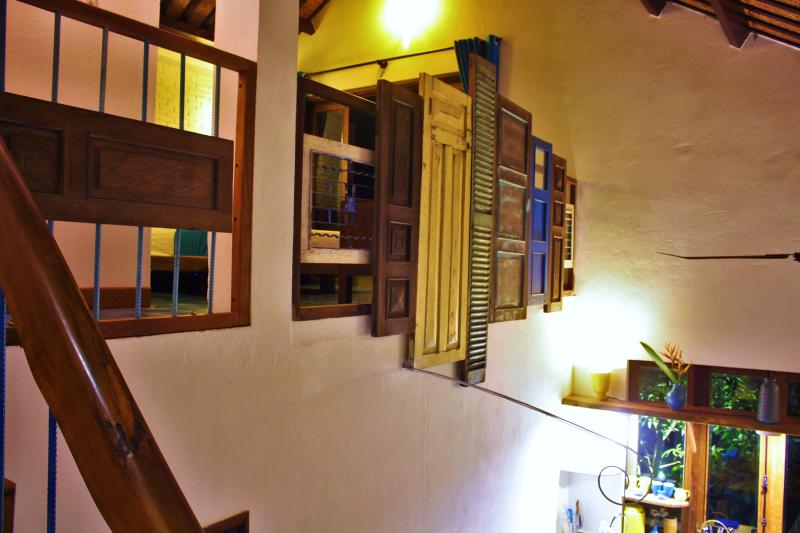 Interior view up at the loft, classic old French doors offer privacy and an artistic touch.