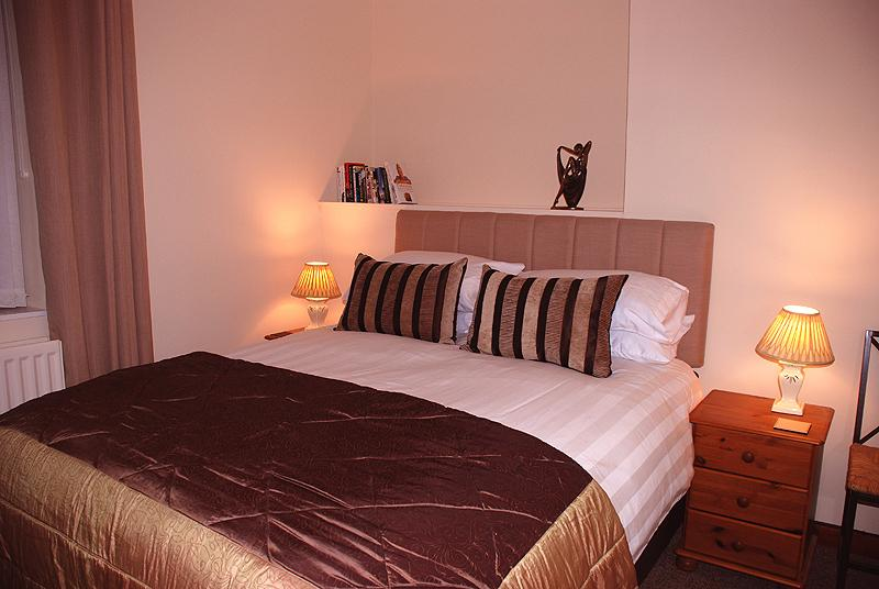 Sumptuous bedroom fitted with a king size Sealy pocket sprung bed.