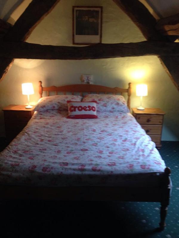 Ysgubor double beamed bedroom.