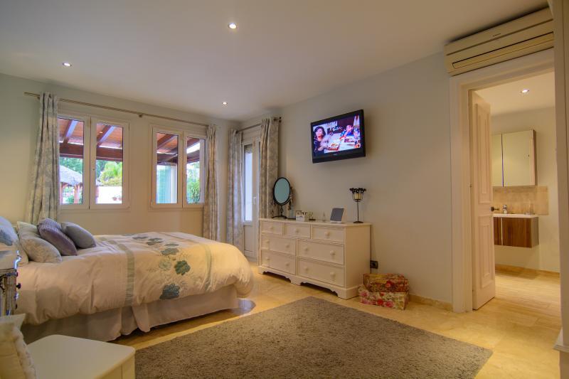 Guest bedroom with en suite bathroom  and TV